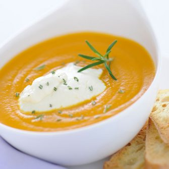 Smooth pumpkin and Robiola Osella soup seasoned with rosemary