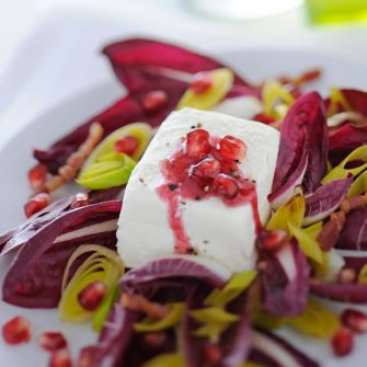 Robiola with Treviso radicchio, bacon and pomegranate