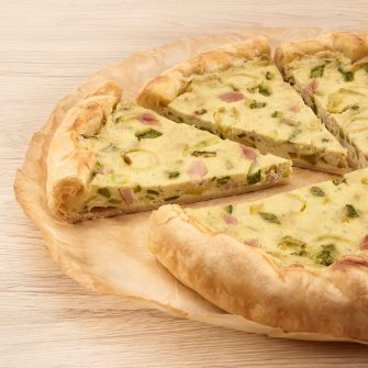 Savoury pie with Robiola Osella with Truffle, cooked ham and courgettes