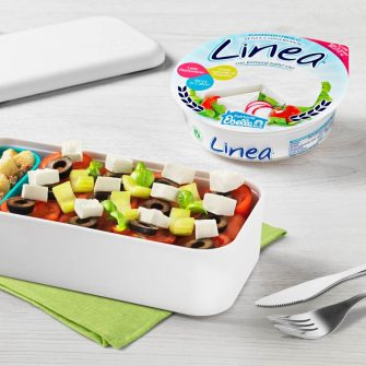 Cubes of Linea Osella with cherry tomatoes, celery, olives and red onion