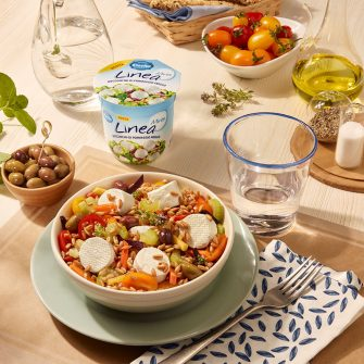 Spelt salad with Linea Minis, carrots, celery, multi-coloured tomatoes and olives